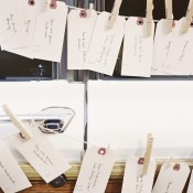 Place Cards Pinned on String With Clothespins