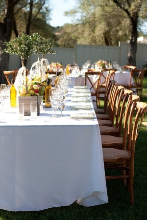 Reception Tables With Olive Trees and Floral Centerpieces