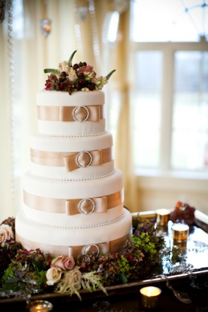 Wedding Cake With Silk Ribbon and Jeweled Brooch on Layers
