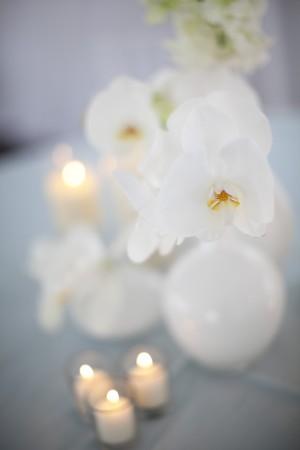 White Orchids in White Milk Glass Vases