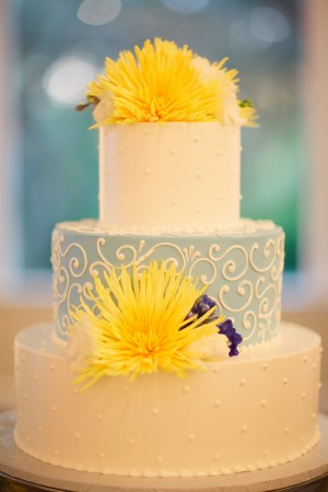 Blue and White Wedding Cake With Yellow Flowers