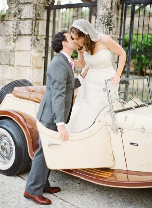 Bride and Groom Kissing in Antique Car
