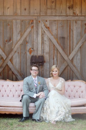Bride and Groom Sitting on Vintage Pink Sofa