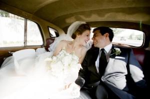 Bride and Groom in Vintage Getaway Car