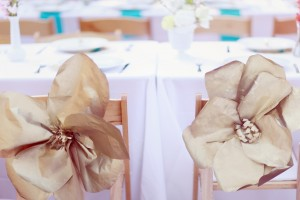 Giant Gold Paper Flowers on Reception Chairs