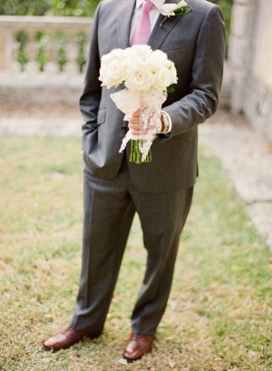 Groom Holding White Rose Bridal Bouquet