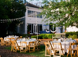Outdoor Reception With Round Tables and Brown Folding Chairs