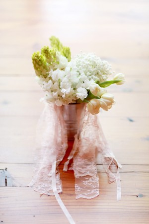 Pale Flowers in Silver Vase With Ribbons and Lace