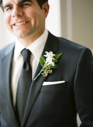 White Boutonniere With Green Berries