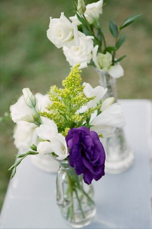 White Roses and Wildflowers in Glass Vases