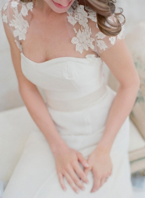 Cap Sleeve Lace Capelet Over Strapless Wedding Gown