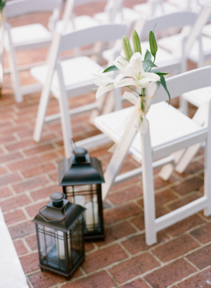 Ceremony Aisle Decor With Orchids and Lanterns