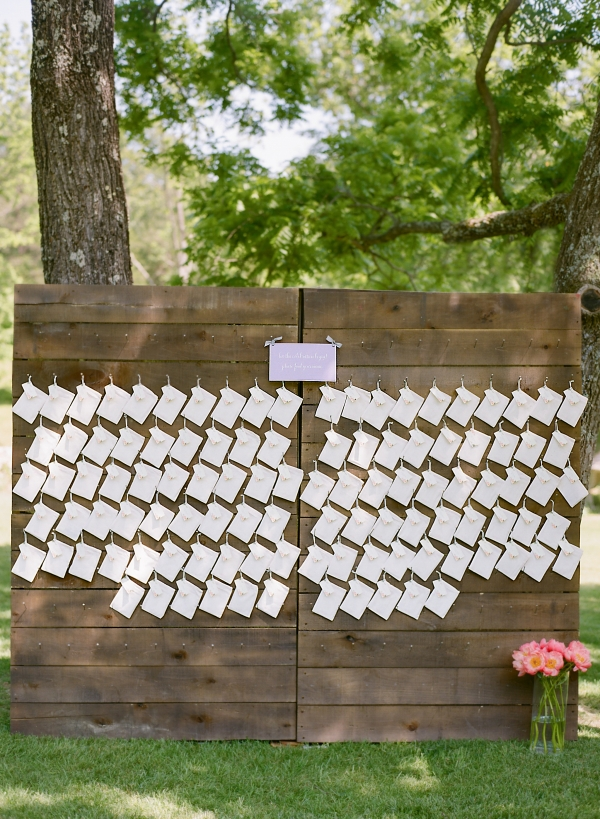 Ceremony Programs Hanging on Wood Board