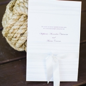 Classic White Wedding Stationery Wrapped in Ribbon