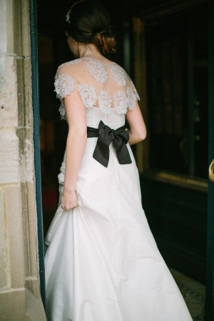 Elegant Lace Gown with Black Sash