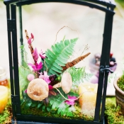 Flower and Feather Arrangement in Iron Lantern