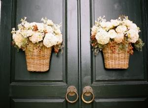 Flowers in Wicker Baskets on Church Doors