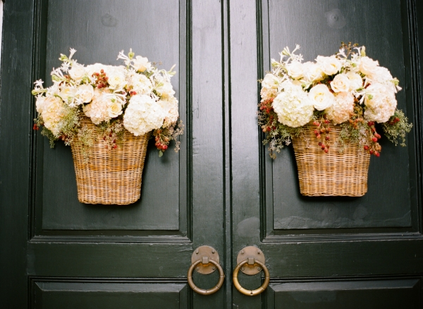 Flowers in Wicker Baskets on Church Doors