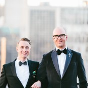 Grooms in Classic Tuxes Against Chicago Skyline