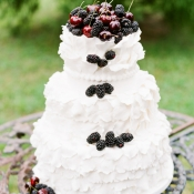 Ruffled Wedding Cake With Berries and Cherries