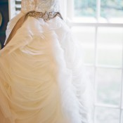 Strapless Wedding Gown With Green Satin Sash and Jewel Detail