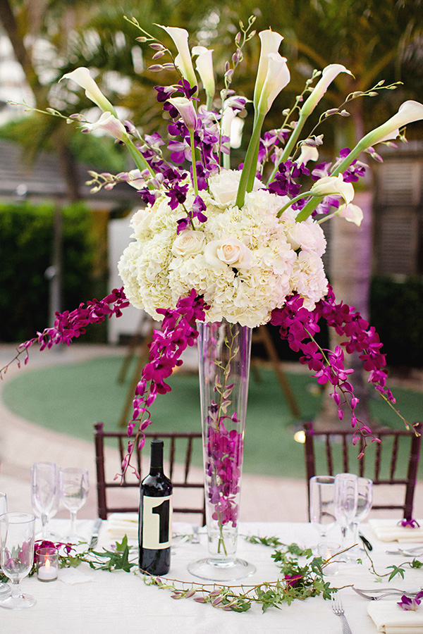 Tall purple and white arrangement with hydrangeas roses