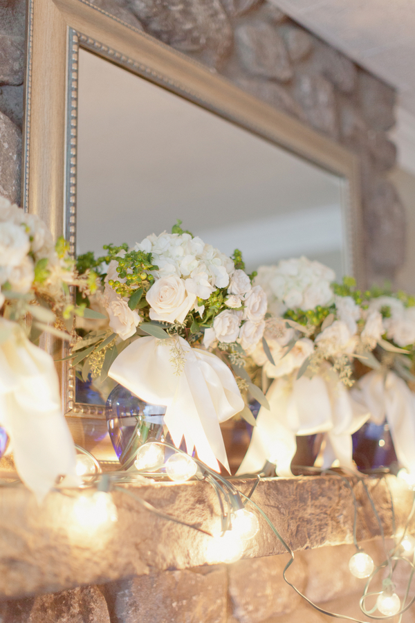 White and Green Bouquets on Stone Mantel