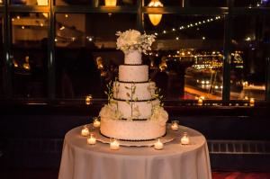 Black and White Wedding Cake With White Roses