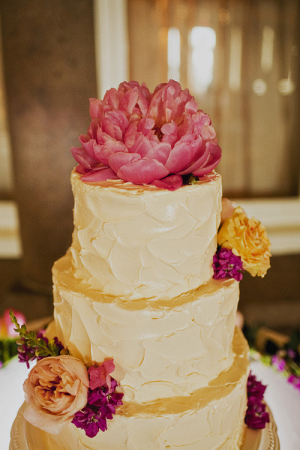 Buttercream Wedding Cake With Pink Flower Topper