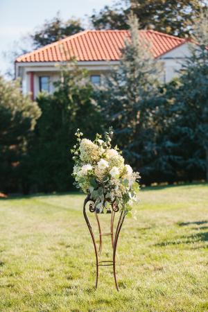 Cream and Green Outdoor Ceremony Arrangement