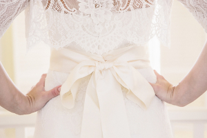 Lace Wedding Gown With Cream Ribbon Sash
