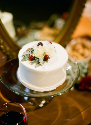 Mini Wedding Cake With Flowers and Red Berries