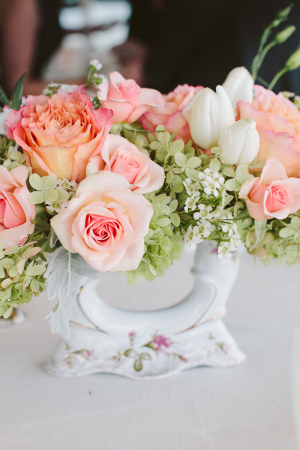 Peach and Green Flowers in Vintage Vase Reception Decor