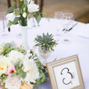 Reception Arrangements With Pale Flowers and Succulents