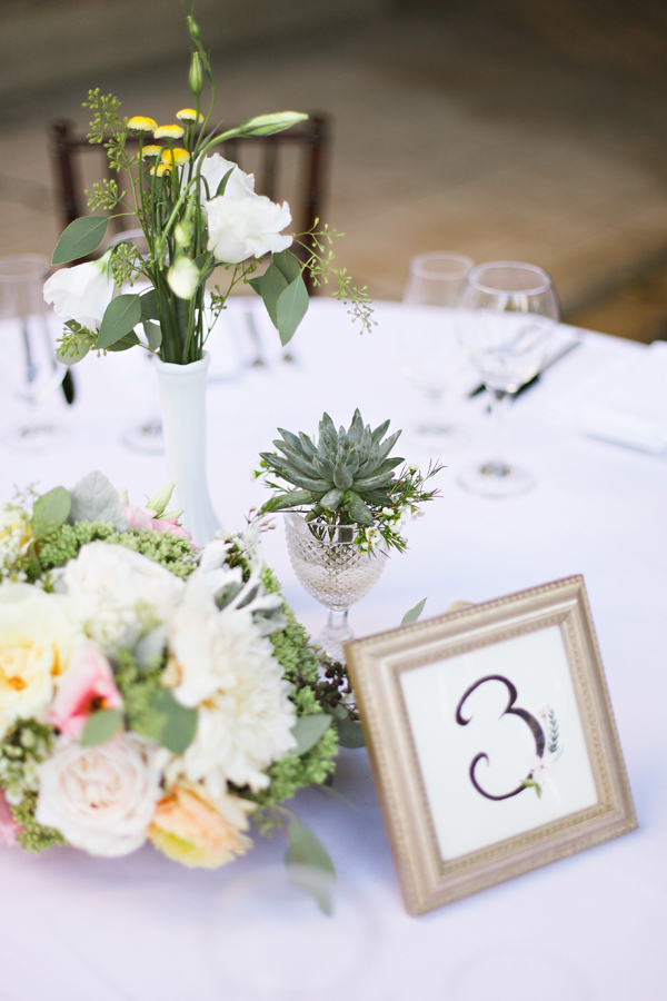 Reception Arrangements With Pale Flowers and Succulents