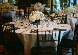 Round Reception Tables and Dark Wood Chairs