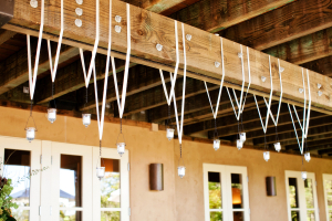 Votives Hanging on Ribbons From Ceiling Beam