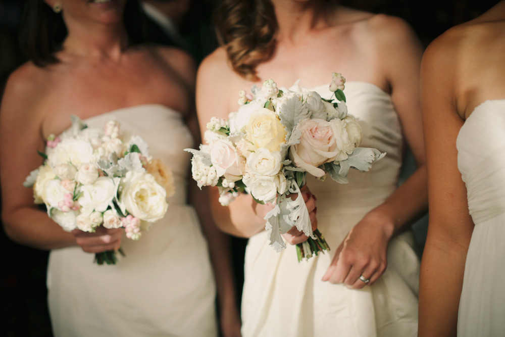 White Bridesmaids Dresses with Ivory Bouquets