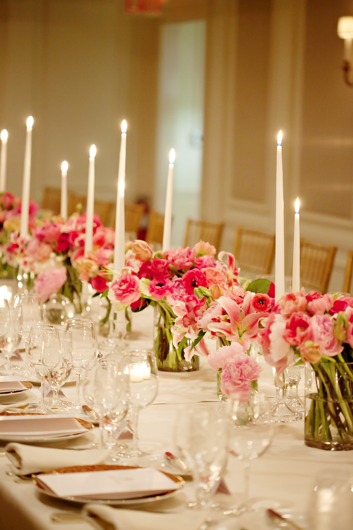 Bold Pink Flowers and Candles Reception Decor