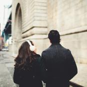 Couple Walking Down City Street