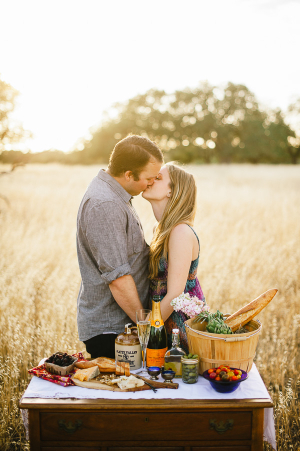 Couple With Picnic Spread in Field
