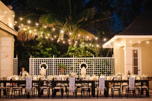 Outdoor Tropical Reception Table With Strung Lights