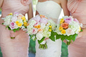 Peach Bridesmaids Dresses and White Bouquets