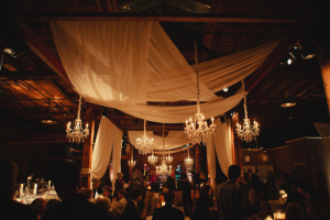 Sheer Drapes and Chandelier Candlelight Reception Decor