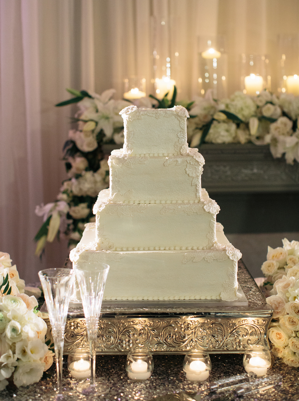 Square Tiered Wedding Cake On Silver Stand
