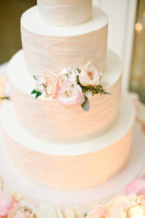 Wedding Cake With Brushed Buttercream and Flowers