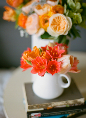 Bold Pink and Orange Flowers in White Vases