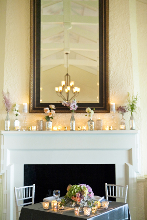Bottles With Flowers on Mantel