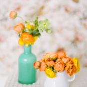 Citrus Colored Flowers in Milk Glass Vases