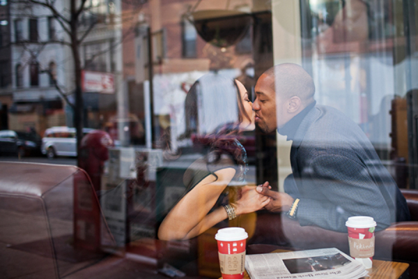 Engaged Couple Kissing in Coffee Shop